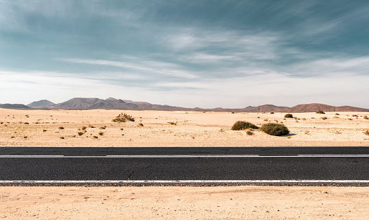 Empty desert road with copy space 1096841112