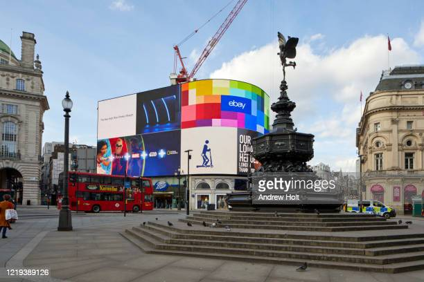 empty deserted area around piccadilly circus during restricted travel of coronavirus covid-19 lockdown in london w1, england - piccadilly stock pictures, royalty-free photos & images