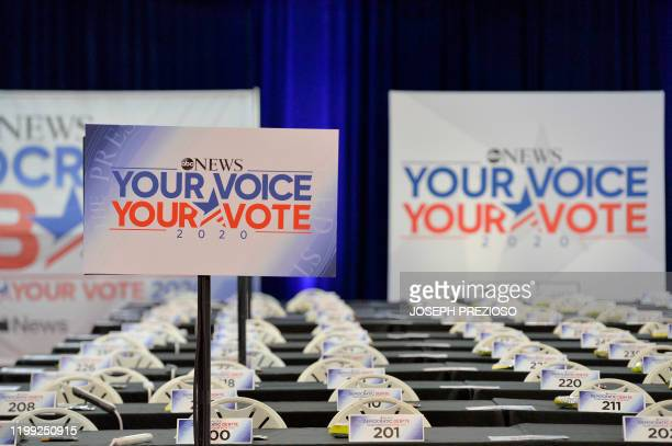 Empty desks are seen in the spin room before the start of the ABC Democratic Debate later in the evening at St Anselm College in Manchester New...