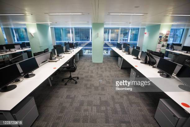 Empty desks stand at Cushman & Wakefield Plc's offices during the first phase of the reoccupation of their headquarters in London, U.K., on...