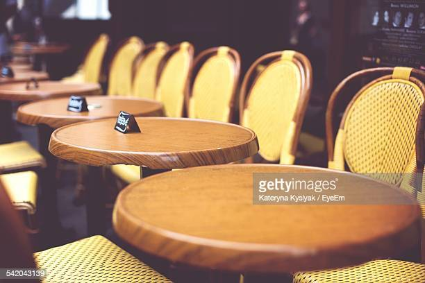 Empty Dining Table In Row At Restaurant