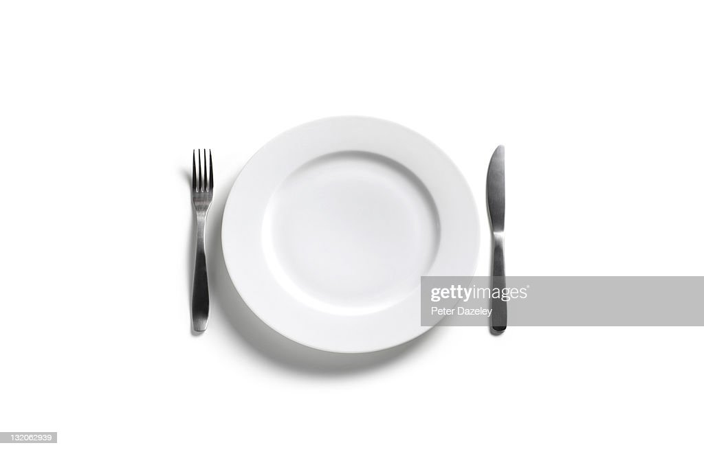 Empty dinner plate on white background : Stock Photo