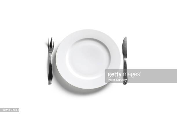 empty dinner plate on white background - silverware stock pictures, royalty-free photos & images