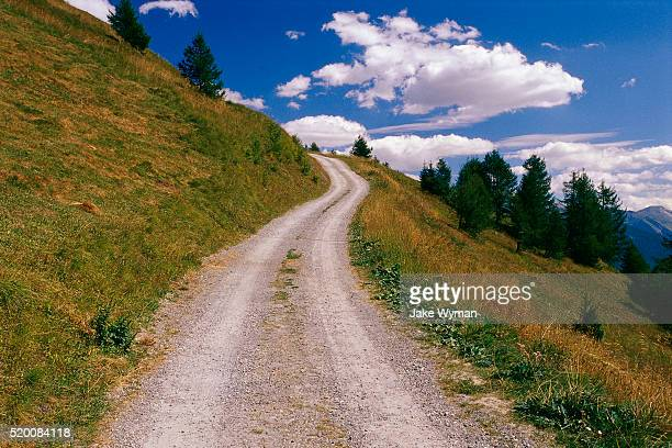 empty dirt road - uphill stock pictures, royalty-free photos & images