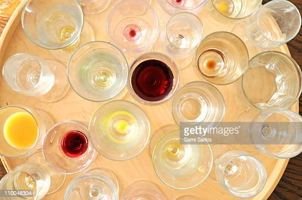 empty dirty glasses on tray, after party - empty glasses after party stock pictures, royalty-free photos & images