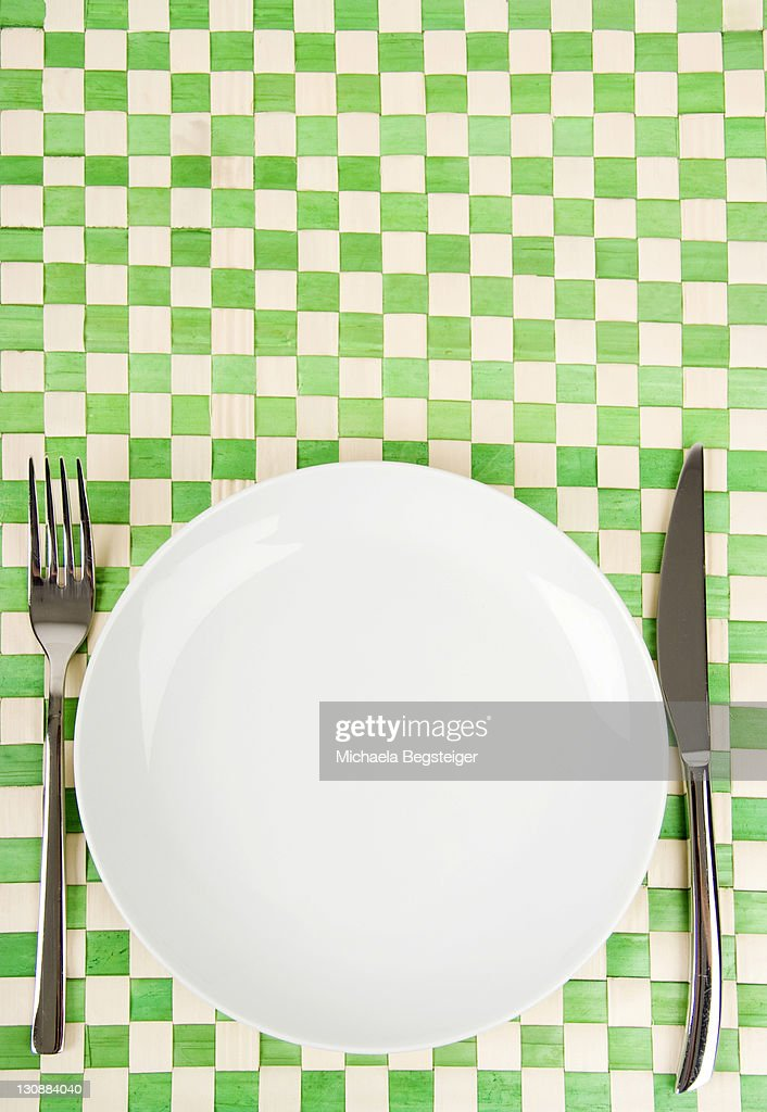 Empty dish, knife and fork : Stock Photo