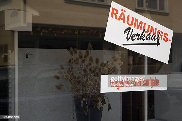 Empty display window with sign clearance sale because of closure of business