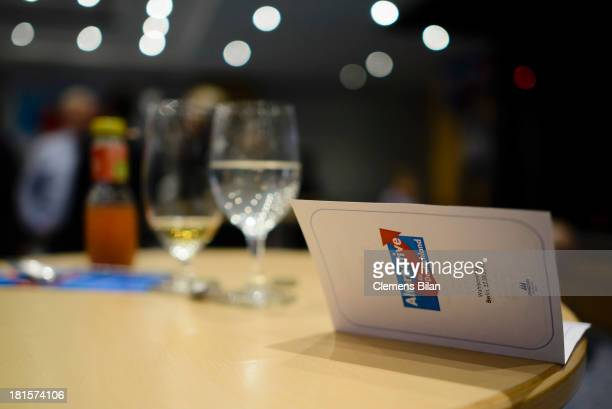Empty drinking glasses and menu card lie on a table at the Euroskeptic political party Alternative fuer Deutschland at poll results that give the...