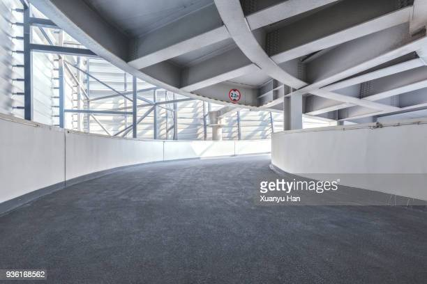 empty driveway in underground parking lot, auto advertising background - man made structure stock pictures, royalty-free photos & images