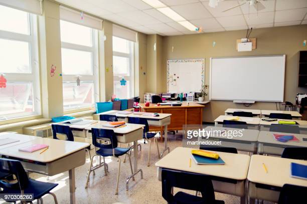 empty elementary classroom during recess. - sparse stock pictures, royalty-free photos & images