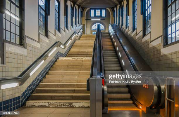 empty escalator by staircase at railroad station - escalator stock pictures, royalty-free photos & images