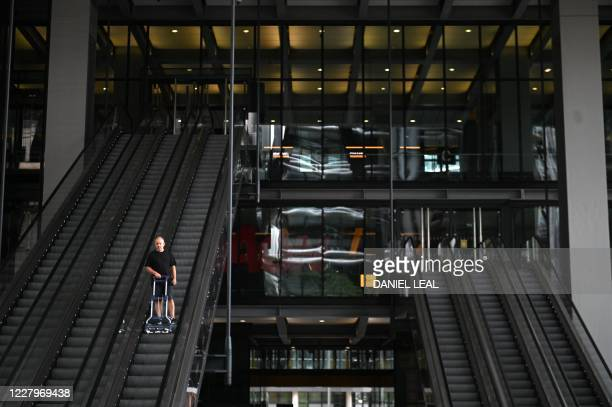 Empty escalators at an office block in the City, a square mile in the heart of London traditionally home of the finance industry on August 6, 2020. -...
