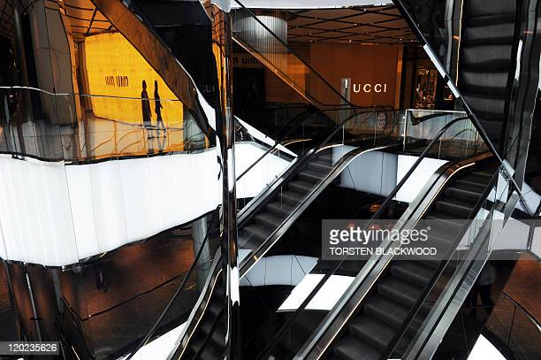 Empty escalators await shoppers in Westfield's flagship retail centre in Sydney on August 2 2011 The Australian retail industry is suffering due to...