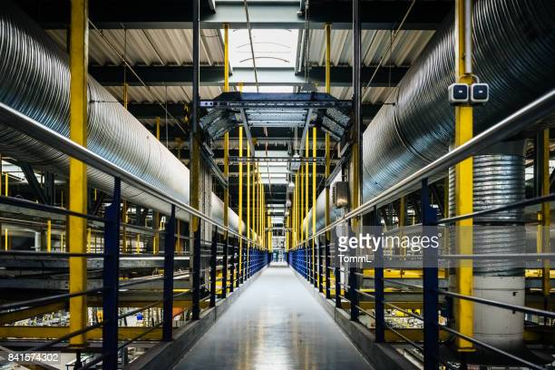empty factory hallway - symmetry stock pictures, royalty-free photos & images