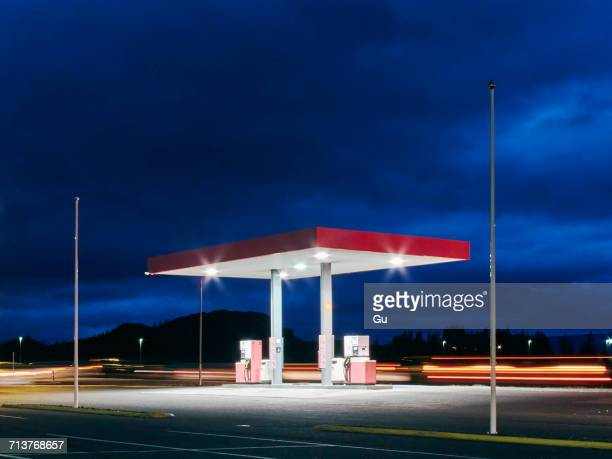 Empty floodlit gas station at night, Hof, Iceland