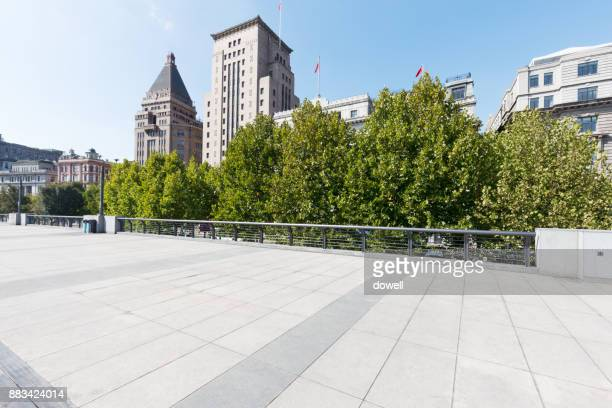 empty floor and abstract modern buildings in midtown of modern city - sidewalk stock pictures, royalty-free photos & images