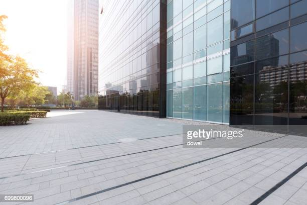 empty floor and glass wall with reflection of modern abstract buildings