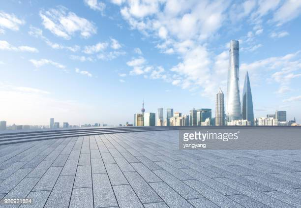 Empty floor and modern city skyline, China