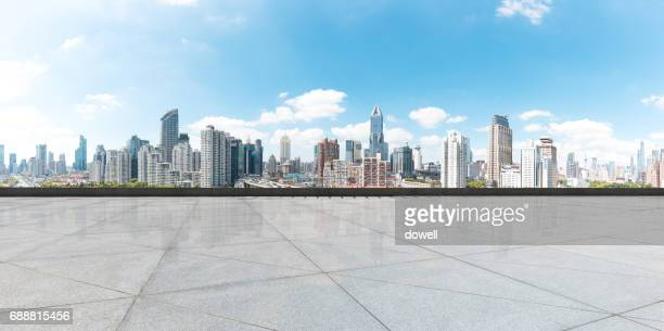 empty floor with modern cityscape in blue sky