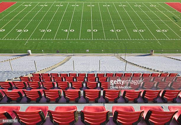 Empty football field and stadium seats.