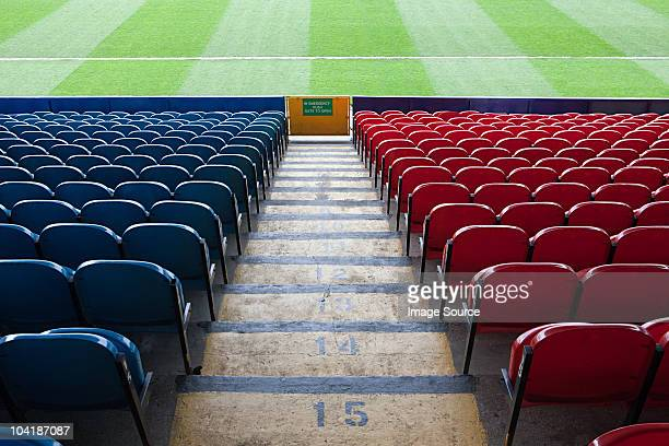 empty football stadium - empty bleachers stockfoto's en -beelden