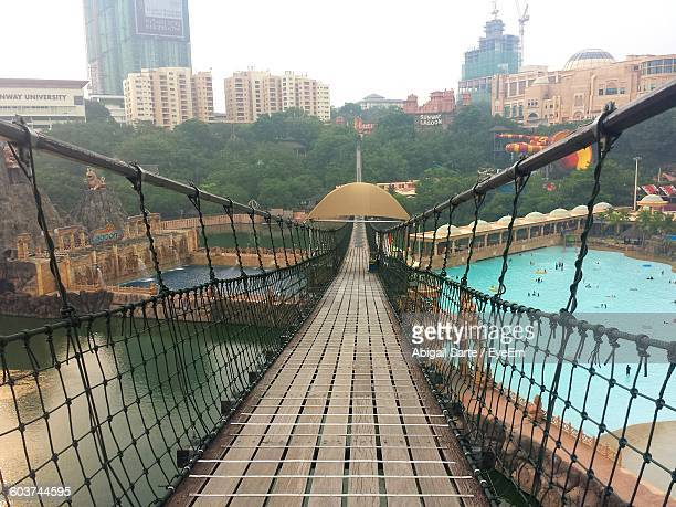 empty footbridge over sunway lagoon in city - lagoon stock pictures, royalty-free photos & images