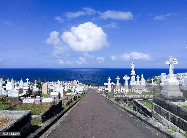Empty Footpath Amidst Waverley Cemetery By Sea Against Sky