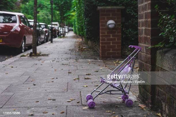 empty footpath by street in city - pushchair stock pictures, royalty-free photos & images