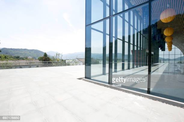 empty footpath front of modern buildings with glass wall