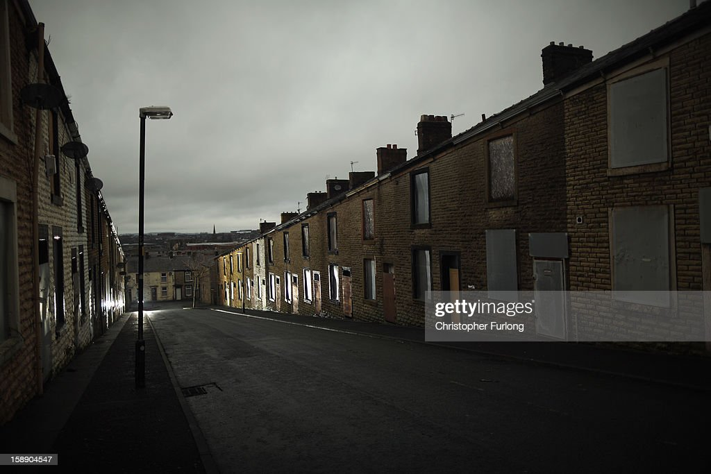 Empty former council houses line a street in the Lancashire town of Accrington as they wait to be modernised by private developers on January 3, 2013 in Accrington, England. There are estimated to be 850,000 empty homes in the United Kingdom even though local councils still have long waiting lists for housing. The terraced houses were due to be rejuvenated by Accrington council but the project was put on hold when the government cut a housing regeneration project.