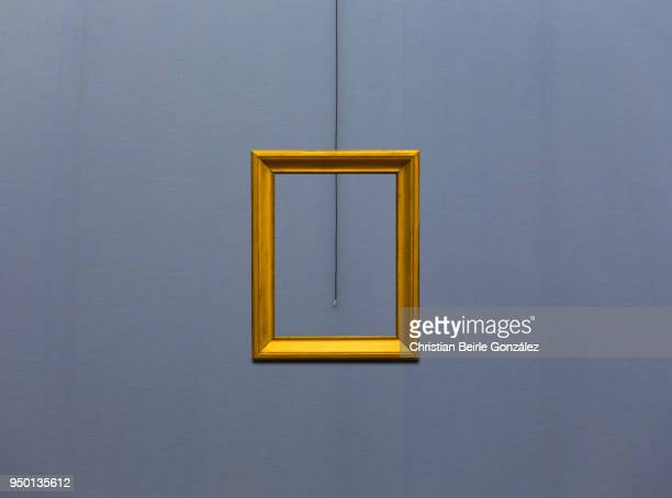 empty frame on blue wall - christian beirle stockfoto's en -beelden