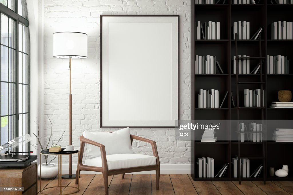 Empty Frame on Living Rooms Wall with Library : Stock Photo