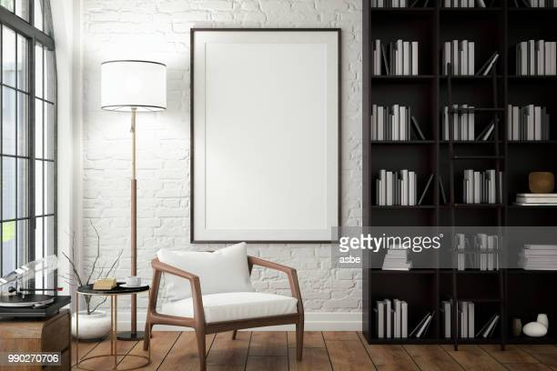 empty frame on living rooms wall with library - moderno foto e immagini stock