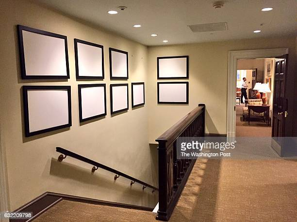 Empty frames that once contained photos of President Obama line the walls of the West Wing The Oval Office can been seen down the hallway The White...