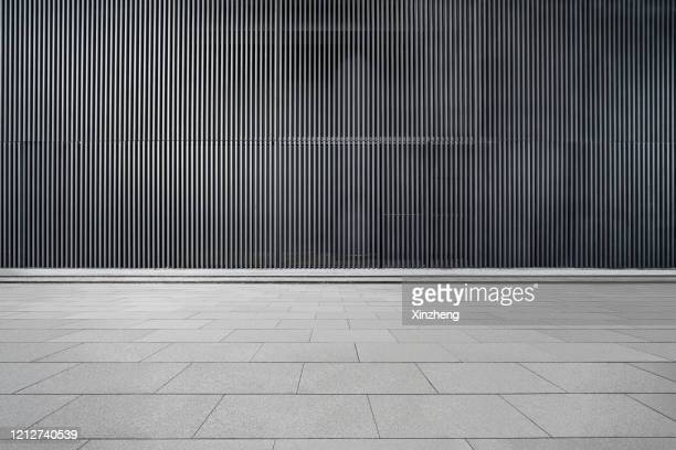 empty futuristic architecture with gray floors and silver metal line wall - parking stock pictures, royalty-free photos & images
