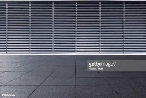 empty Futuristic Architecture with gray floors and silver Metal line wall