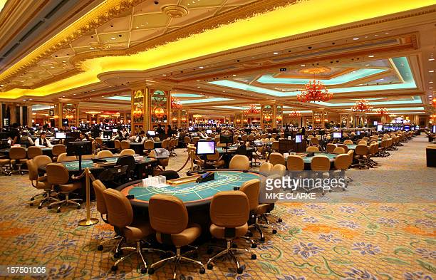 Empty gaming tables are seen lined up at the Venetian Resort in Macau 27 August 2007 a day before the 24 billion USD gamble opens to the public The...