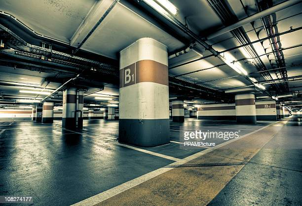 empty garage parking lot - empty lot night stock pictures, royalty-free photos & images