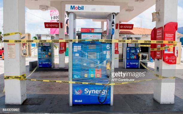 Empty gas pumps are wrapped and surrounded by tape at a Mobil Gas Station in the Little Havana neighborhood in Miami Florida September 8 2017 Florida...