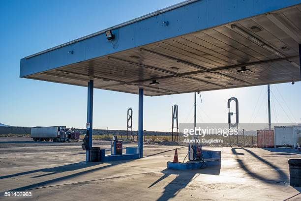 Empty gas station in remote landscape