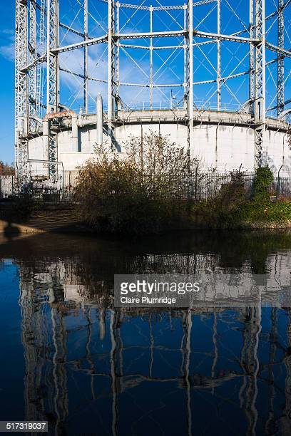 empty gasometer reflected in the water - claire plumridge stock pictures, royalty-free photos & images