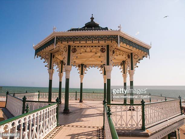 Empty Gazebo At Brighton Pier By Sea Against Clear Sky On Sunny Day