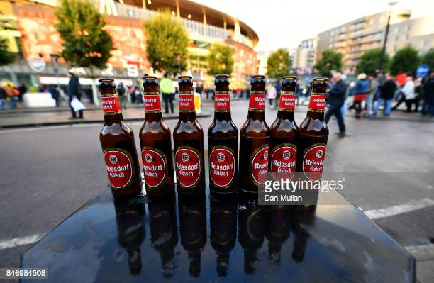Empty german beer bottles are lined up outside of the Emirates Stadium ahead of the UEFA Europa League group H match between Arsenal FC and 1 FC...