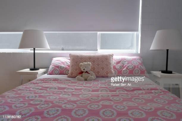 empty girl bedroom - rafael ben ari stock-fotos und bilder