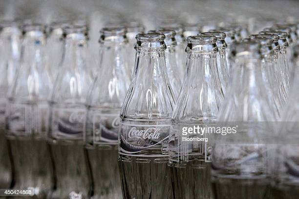Empty glass bottles of CocaCola Light also known as diet Coke travel along a conveyor belt ahead of filling at the Lanitis Bros Ltd bottling plant...