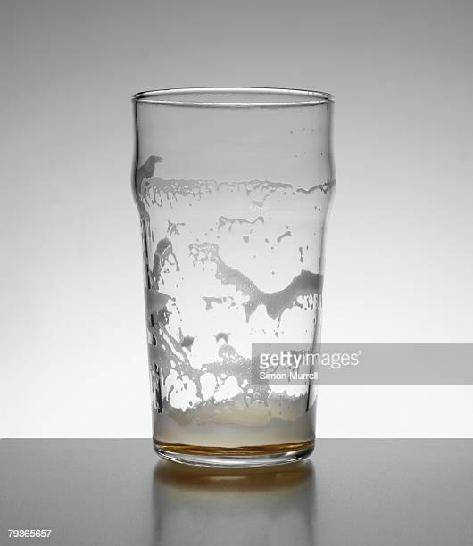Empty glass of beer indoors