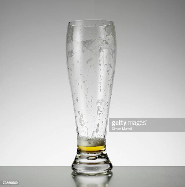 Empty glass of beer indoors