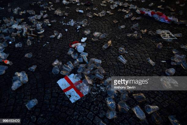 Empty glasses and flags are seen left behind after football fans watched England lose to Croatia at the Auto Trader World Cup semifinal screening in...