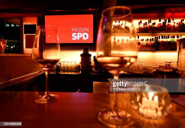 Empty glasses are pictured in the restaurant near the State Parliament of Hesse where supporters of Germany's Social Democratic Party reacted after...