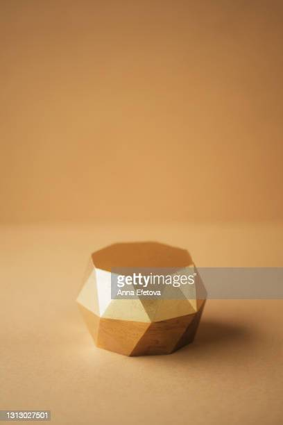 empty gold podium against beige background. good place for demonstrating your cosmetic product. front view and close-up - award winning stock pictures, royalty-free photos & images